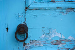 Urban Decay. Paint peeling from an old door. Turquoise colour stock photography