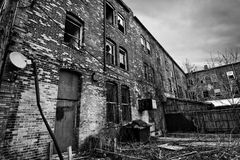 Urban Decay. Black and white photo of an old run down brick building in an urban setting. Sadly these are seen frequently in American cites Stock Image