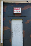 Urban Decay Doorway. Business dining room entrance with signs of urban decay Royalty Free Stock Image