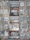 Urban Decay. An old distressed apartment high rise building enhanced with added crackle grunge texture Stock Photography