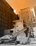 Urban Demolition. Scene with bulldozer and demolished building Stock Image