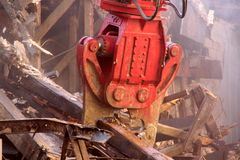 Urban demolition, hydraulic pliers, rubble Royalty Free Stock Photo