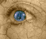 Urban destruction. Abstract of urban destruction-woman's eye looking at industrial building with dry cracked skin royalty free stock photography