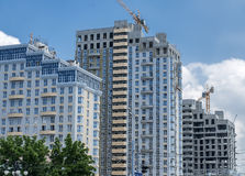 Urban development. construction of a new residential area. Three successive high-rise residential buildings in various stages of construction Stock Photo