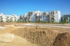 Urban development with construction site and new residential buildings. Urban development with construction site and new residential building royalty free stock image