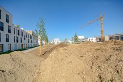 Urban development with construction site and new residential buildings. Urban development with construction site and new residential building in the City royalty free stock photography