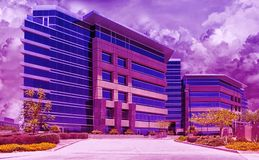 Urban Downtown Skyline Modern Buildings In A Purple Haze Royalty Free Stock Images