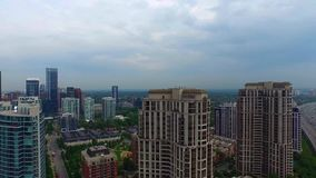 Urban downtown Toronto cityscape with tall skyscrapers and towers in 4k aerial. Urban downtown Toronto cityscape with tall skyscrapers and towers stock video footage