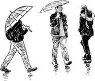 Urban dwellers in the rain Royalty Free Stock Image