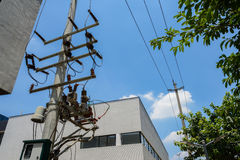 Urban electrical pole and equipment in sunny summer sky Royalty Free Stock Images
