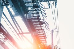 Urban electricity high power poles energy supply. Distribution and transmission high voltage supply concept vintage color tone Stock Photo