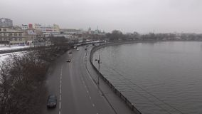 Urban embankment with cars on winter cloudy day. Moscow, Russia, 4K footage stock footage