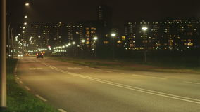 Urban Evening Road Time Lapse. Static medium long shallow depth of field time lapse shot during the evening of cars driving with headlights and tail lights stock footage