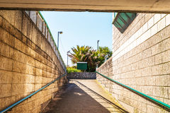 Urban exit with underground passage with balustrade, billboard b Royalty Free Stock Photo