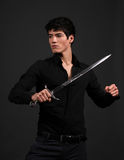 Urban Fantasy. Male model posing in an urban fantasy outfit with a sword Stock Images