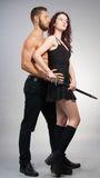 Urban Fantasy. Couple in contemporary outfits, with the women holding a sword royalty free stock photo