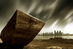 Urban fantasy landscape. The other side of the city, abandoned wooden boat, urban fantasy landscape, exaggerated performance Royalty Free Stock Photography