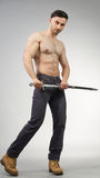 Urban Fantasy. Male model posing in a contemporary outfit with a sword royalty free stock image