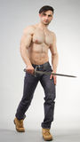 Urban Fantasy. Male model posing in a contemporary outfit with a sword royalty free stock photos
