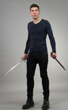 Urban Fantasy. Male model posing in a contemporary outfit with a sword royalty free stock photo
