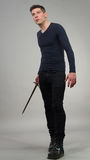 Urban Fantasy. Male model posing in a contemporary outfit with a sword stock images
