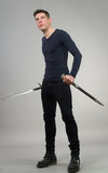 Urban Fantasy. Male model posing in a contemporary outfit with a sword stock image