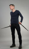 Urban Fantasy. Male model posing in a contemporary outfit with a sword stock photos