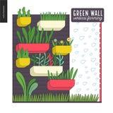 Urban farming and gardening - vertical farming. Urban farming, gardening or agriculture. Green wall - vertical farming. A wall with flowerpots and irrigating Royalty Free Stock Photo