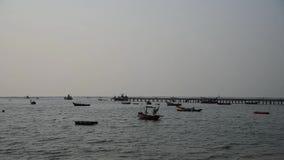 Urban fishing boat floating beside jetty stock video