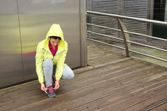 Urban fitness female runner lacing sport footwear Stock Image