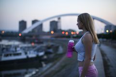 Urban fitness girl with water bottle stock image