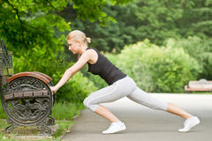 Urban fitness - push ups. Woman doing push ups on bench in urban fitness exercise Royalty Free Stock Photography