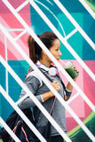 Urban fitness woman drinking detox smoothie Stock Images