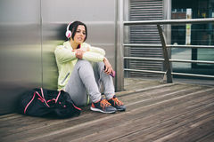 Urban fitness woman resting after workout Stock Photography