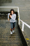 Urban fitness woman running and climbing stairs Stock Photography