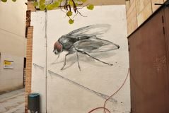 Urban fly wall-art in Zamora, Spain stock images
