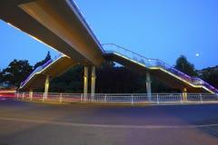 Urban footbridge and road intersection of night scene Stock Photography