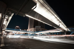 Urban footbridge and road intersection of night scene. Intersection of urban footbridge and highway auto with light trails of night scene Stock Image