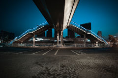 Urban footbridge and road intersection of night scene. Intersection of urban footbridge and highway auto with light trails of night scene Stock Photo