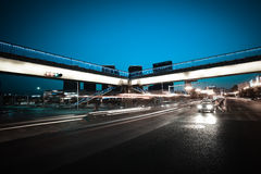Urban footbridge and road intersection of night scene. Intersection of urban footbridge and highway auto with light trails of night scene Stock Images