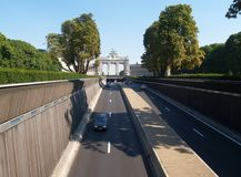 Urban freeway in park. Brussels Cinquantenaire (half-centennial) monument, triumph arc, and park. View on the triumph arc and a major underground traffic artery Stock Images