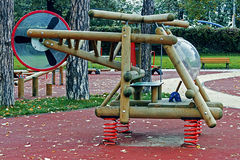 Urban furniture for children 1. Furniture for children's amusement parks. Colorful toy helicopter, of wood, metal and plastic Royalty Free Stock Images