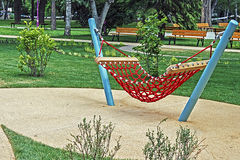 Urban furniture for children 8. Furniture for children's amusement parks. Hammock with string red Royalty Free Stock Photography