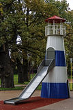 Urban furniture for children 2. Furniture for children's amusement parks. Tower that mimics a marine beacon and is used as a toboggan Royalty Free Stock Image