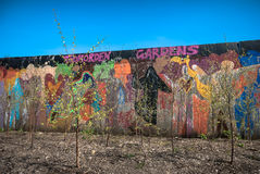 Urban Garden. Community urban garden with painted art backdrop in Todmorden Gardens, Uk Stock Image