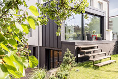 Urban garden outside modern scandi villa. Inspiring terrace and urban garden outside modern scandi villa Royalty Free Stock Images