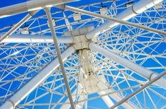 Urban geometry ferris wheel. View from below metal framing Stock Image