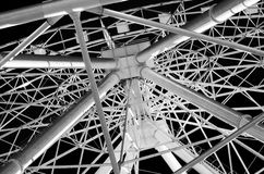 Urban geometry ferris wheel. View from below metal framing Stock Images
