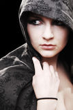 Urban Girl. Urban/Modern model looking to side wearing a hoodie royalty free stock photos