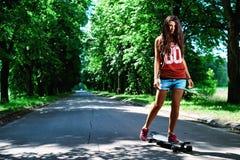 Urban girl with longboard Stock Photo